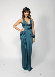 Tamera Mowry showed off her smoking hot curves at the 2011 NAACP Image Awards in a draped teal dress.