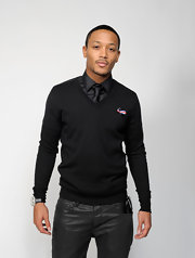 Romeo Miller paired his leather pants with a classic v-neck sweater for the NAACP Image Awards.