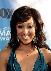 The actress attended the NAACP Image Awards with sparkling gemstone pear earrings. The baubles were framed in gold trim.