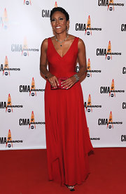 Robin Roberts attended the CMA Awards looking like a goddess in a gorgeous flowy red gown.