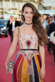 Charlotte Le Bon paired a beaded clutch with a colorful embroidered dress, both by Dior, for the Deauville American Film Festival opening ceremony.