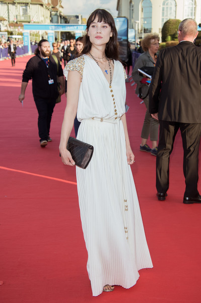 Astrid Berges Frisbey was boho-glam in a white Chanel maxi dress with a pleated skirt and embellished cap sleeves at the Deauville American Film Festival opening ceremony.