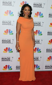 Sanaa Lathan was a vibrant beauty in this orange evening dress at the NAACP Image Awards.