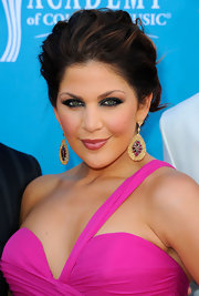 Hillary Scott completed her soft updo with bold bangle earrings adorned with pink stones.