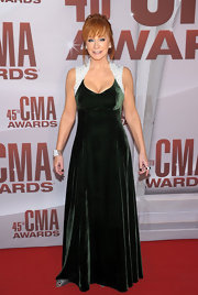 Reba McEntire wore a green velvet design with beaded shoulders for the CMA Awards.