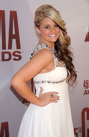 Lauren Alaina wore a pair of sparkly tanzanite crystal Play earrings and a silver crystal poison ring.