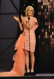 Some of Carrie's favorite designs are the eccentric yet elegant creations of Georges Chakra. The country songstress made a statement on stage in a coral cocktail dress with an extravagant tulle train and unique scaly texture. This was definitely Carrie's most standout style of the night!