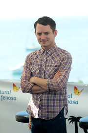 Elijah Wood posed wearing a plaid button-down shirt at the 45th Sitges Film Festival.