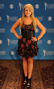 Miranda wore an abstract print dress with a thick leather belt for the CMA nominations.