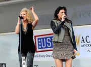 Karen Fairchild toughened up her girly dress with a two-tone motorcycle jacket at the USO concert.