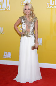 Carrie looked like a goddess in this gold applique white Grecian gown at the CMA Awards.
