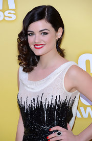 Lucy looked like a retro glam princess with these side-swept curls and red lipstick.