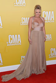 Miranda Lambert enchanted on the red carpet at the 2012 CMA Awards in a whimsically romantic blush-toned gown.
