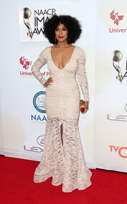 Tracee Ellis Ross flaunted her curves at the NAACP Image Awards in a body-con Michael Costello gown with a plunging neckline and a front slit.