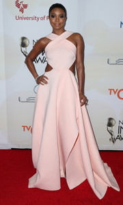 Gabrielle Union looked ultra modern yet ladylike in a pink Gauri & Nainika gown with crisscross shoulder straps, waist cutouts, and a voluminous skirt during the NAACP Image Awards.