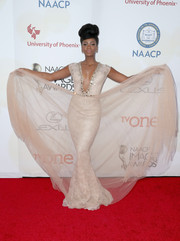 Teyonah Parris stole the show in an ultra-glam nude Amato by Furne One mermaid gown, made more dramatic with the addition of a tulle skirt overlay, during the NAACP Image Awards.