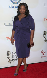 Octavia Spencer donned a figure-flattering purple wrap-bodice dress by her favorite Tadashi Shoji for the NAACP Image Awards.