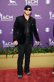 Sleek pinstriped trousers made Brantley Gilbert's black-on-black look anything but dull.