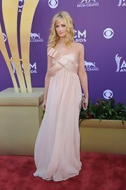 Beth Behrs donned this airy blush gown with a bow adornment to the Academy of Country Music Awards.