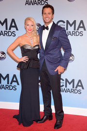 Caroline Boyer exuded Old Hollywood glamour in a strapless black peplum gown during the CMA Awards.