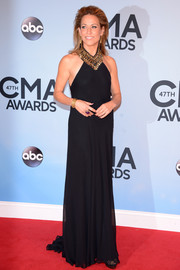 Sheryl Crow looked diva-ish at the CMA Awards in a flowy black Ralph Lauren evening dress with an embellished neckline.