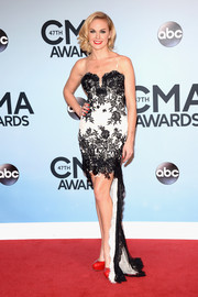 Laura Bell Bundy walked the CMA Awards red carpet looking chic in a black-and-white lace-embellished fishtail gown.