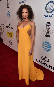 Gugu Mbatha-Raw chose a simple yet sophisticated orange halter gown by Narciso Rodriguez for her NAACP Image Awards look.