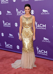 Jana Kramer looked simply elegant on the ACM red carpet, where she wore this gold beaded Egyptian-inspired gown, featuring a long tulle train.