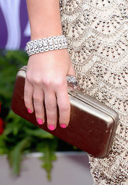 Ashley Monroe chose a simple gold clutch with a crystal clasp to top off her elegant red carpet look.