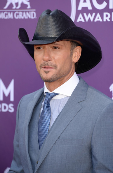 Tim McGraw chose his signature black cowboy hat for his suave look at the ACMs.