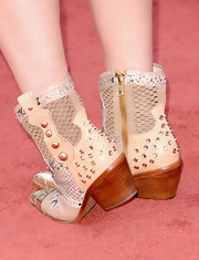 It only seemed fitting for RaeLynn to wear cowboy boots to the 2013 ACMs, but to make them red carpet-appropriate, she picked a sparkly, studded pair.