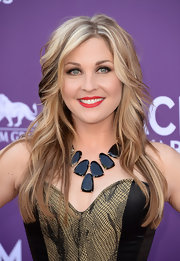 Sunny Sweeney showed how to make a long layered cut red carpet-appropriate when she added a slight wave to her locks, flipping them both out and under for added texture.