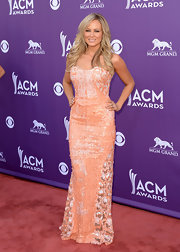 Jewel simply sparkled on the ACM red carpet when she chose this peach strapless gown, featuring sequin embellishments and a fitted mermaid skirt.