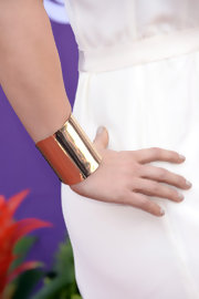 A wide gold cuff added an extra touch of modern flare to her sleek ACM red carpet look.