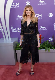 Faith Hill said goodbye to the floor-length gown and hello to this mid-calf lace gown, featuring a high front slit.