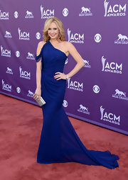 Ashley Jones showed off her toned arms in this electric blue one-shoulder dress, featuring a flowing train.