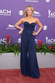 Sheryl Crow showed off her perfectly toned arms in this corset-style jumpsuit that featured wide '70s-inspired legs.