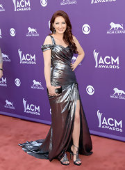 Katie Armiger totally shined on the red carpet when she wore this gunmetal-colored gown, featuring a ruched bodice and flowing skirt.