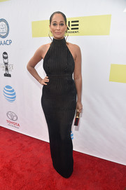 Tracee Ellis Ross showed off her shape in a form-fitting black halter gown by Ulyana Sergeenko that she wore with a Naeem Khan clutch at the NAACP Image Awards.