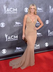 Miranda Lambert looked ravishing in a low-cut nude mermaid gown during the ACM Awards.