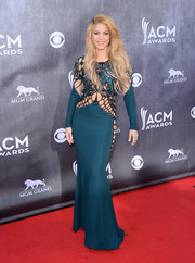 Shakira sent pulses racing at the ACM Awards in a teal Zuhair Murad gown with cutouts on the bodice, sleeves, and down the sides.
