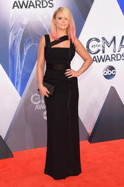 Miranda Lambert cut a shapely silhouette on the CMA Awards red carpet in a black Versace column dress with a strappy neckline.