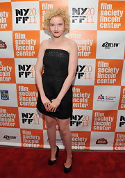 Julia Garner donned a little black strapless dress and tight blond ringlets at the 'Martha Marcy May Marlene' premiere.