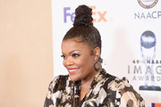 Yvette Nicole Brown swept her hair up into a partially braided top knot for the NAACP Image Awards nominees luncheon.