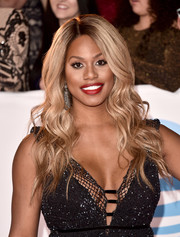 Laverne Cox attended the 2018 NAACP Image Awards wearing her hair in fairytale waves.