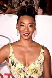 Betty Gabriel pulled her locks up into a loose, high bun for the 2018 NAACP Image Awards.