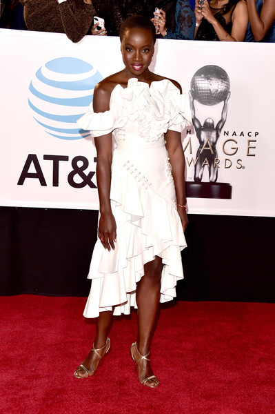 Danai Gurira finished off her red carpet attire with strappy gold heels by Jimmy Choo.