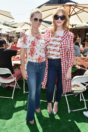 Christina Hendricks looked darling in her red and white gingham coat at the Crab Cake LA fundraiser.