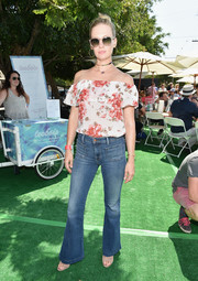 January Jones oozed girly charm wearing this floral off-the-shoulder top at the Crab Cake LA fundraiser.