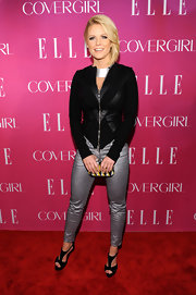 Carrie Keagan chose a fitted zip-up with leather zig-zag panels for her red carpet look at the Elle Women in Music Celebration.